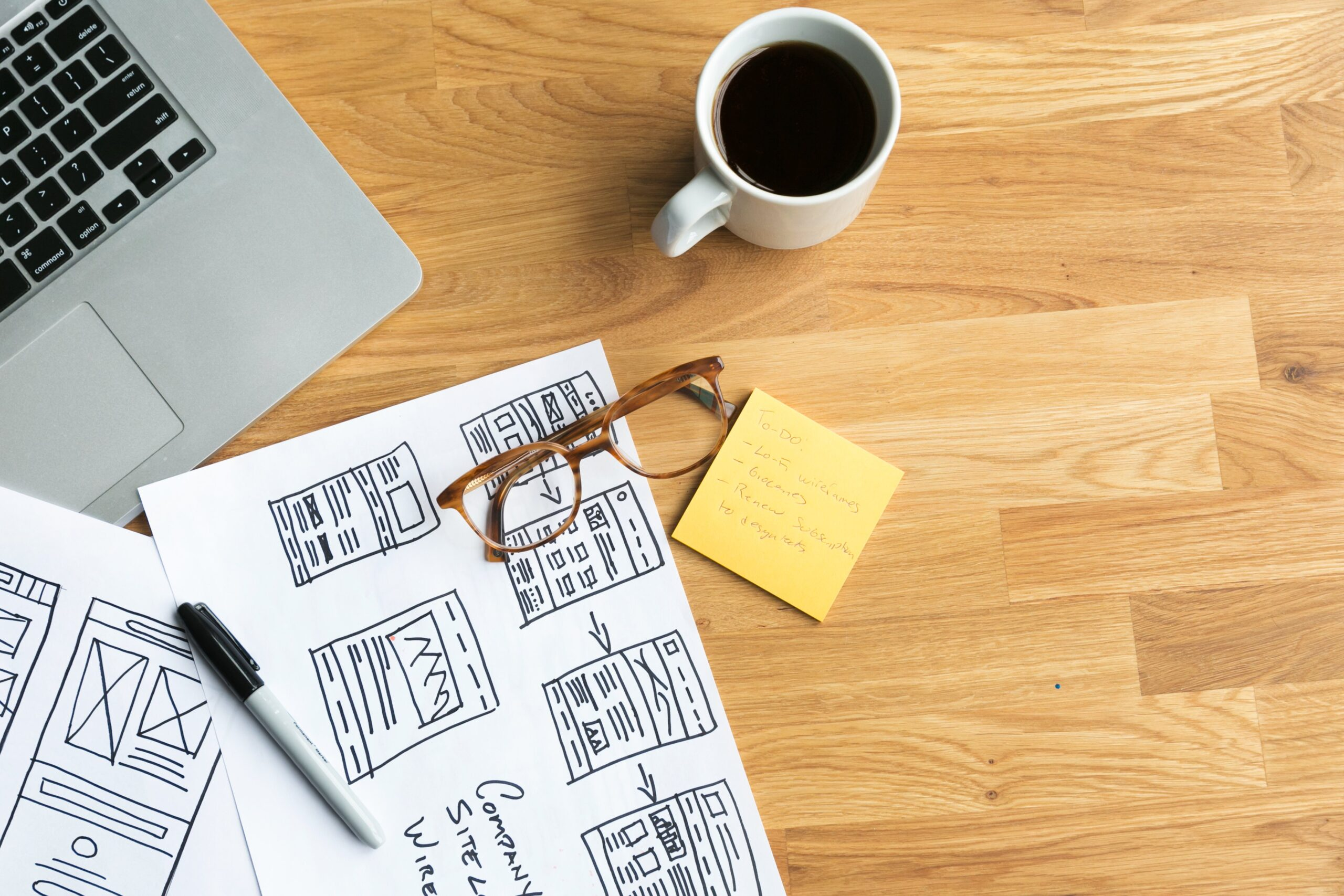 designers-desk-with-coffee-wireframes