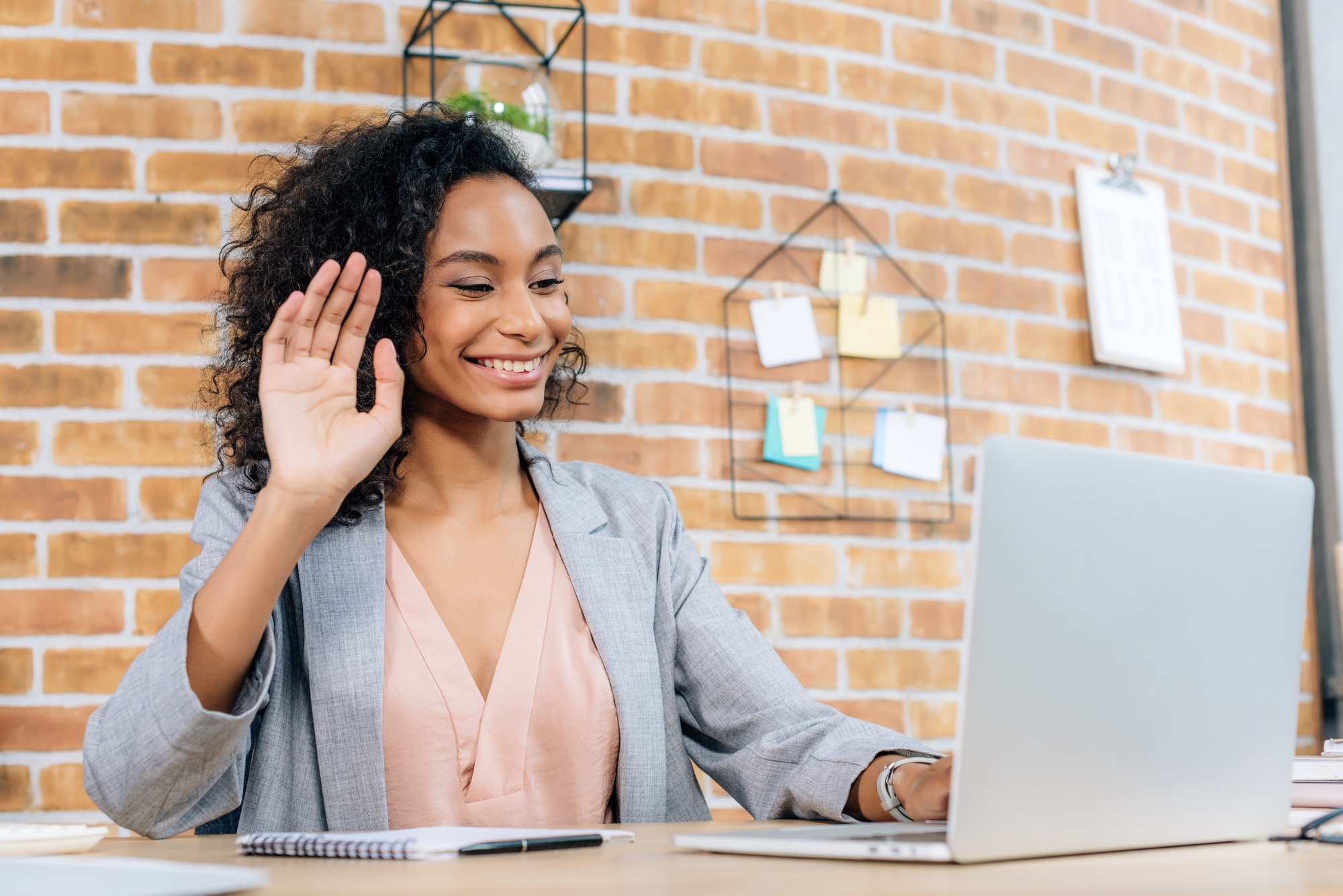 smiling african american Casual businesswoman using laptop while having Video Chat